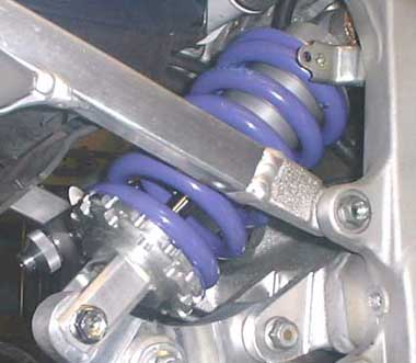 The Maxton Damper and Billet Alloy Rocker. They bolt where the original spring unit was bolted.